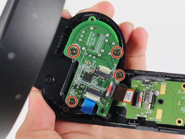 Remove four 4mm Phillips #0 screws.
