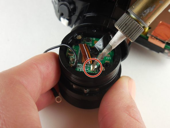 Remove the ribbon connecter from the lens unit by soldering.