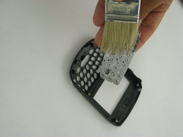 If you are cleaning the keypad, use a fine brush to wipe any dirt from both the front and back of the pad.