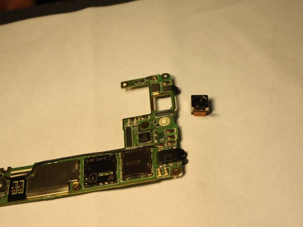 Image 3/3: It is not necessary to remove logic board for removal of the back camera.