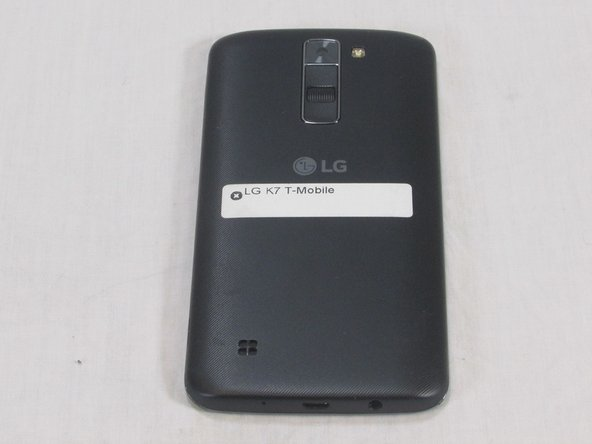 Flip the LG K7 over so that the back of the phone is facing up.