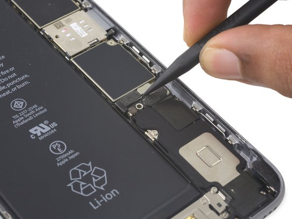 Use a spudger or a clean fingernail to disconnect the battery connector by prying it straight up off the logic board.