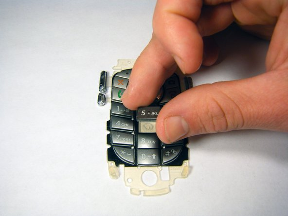 Carefully place key onto the key pad so that it will be properly oriented and in line with the other keys.