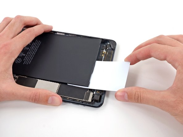 Again, press the card in further, to break more of the adhesive behind the battery.