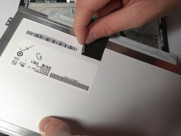 Use your fingers to peel back the adhesive tape located on the back of the screen.