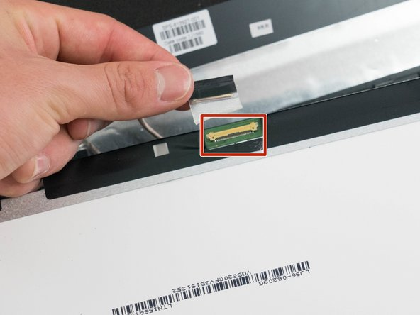 Disconnect the single cable from the back of the display.