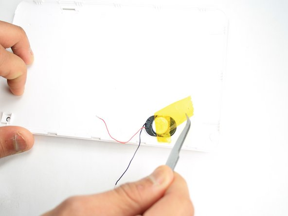 Remove yellow tape from the speakers and use tweezers to pull speaker out.