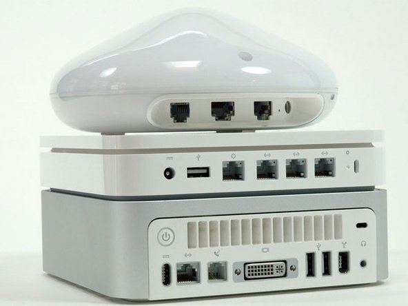 From bottom up: Mac Mini, new base station, old base station.