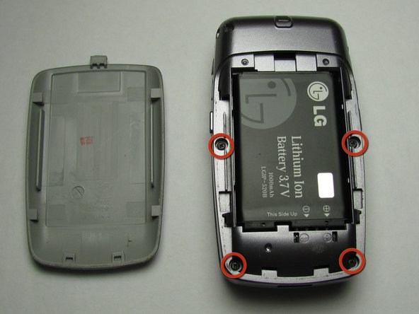 Take the Philips screwdriver and unscrew the four visible screws on the backside of the phone indicated by the four red circles.