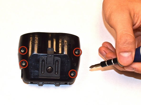 Using a Phillips head screwdriver remove the screws on the bottom of the device.