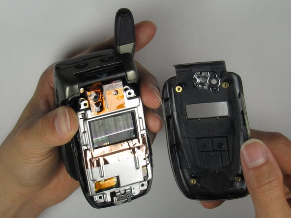 Completely remove the outer casing from the phone.