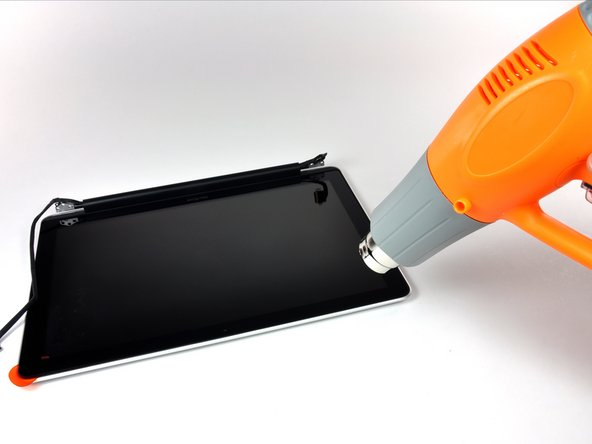 Image 1/2: Attach a suction cup near the upper left corner of the glass display panel.