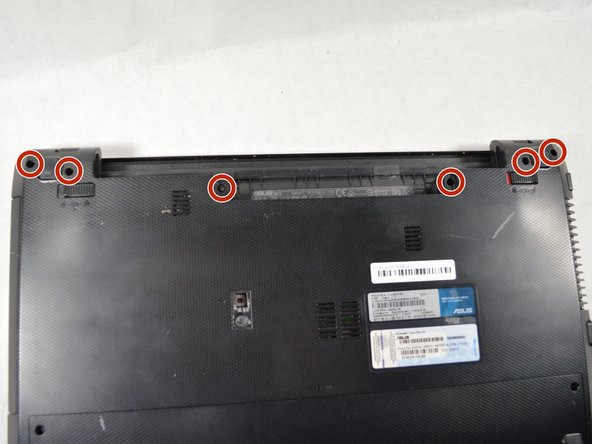 Remove the six 2 mm Phillips head screws on the top edge of the laptop using PH00 screw driver.