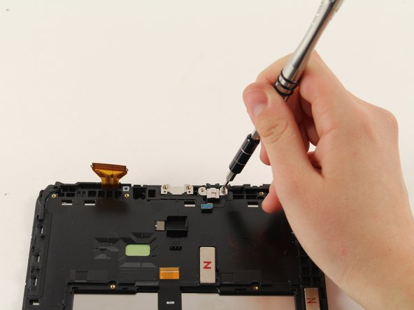 Use Phillips # 000 to remove two of the 4 mm .3 cm screws around the headphone jack.