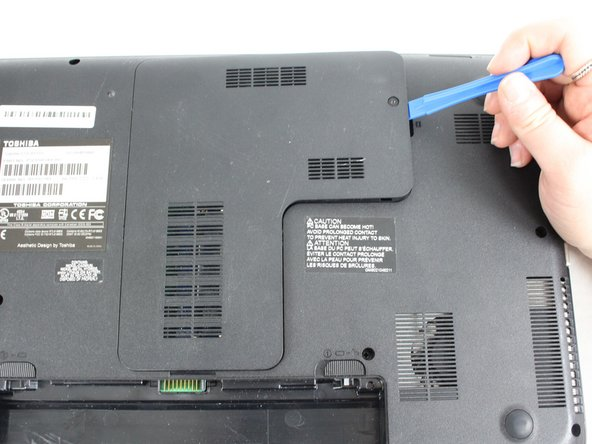 Use the plastic opening tool to pry open the back panel. Make sure to loosen all four sides then lift up.