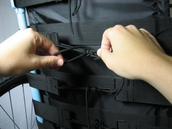 Image 2/2: '''Remove''' the back padding by untieing the straps attached to the back pad.