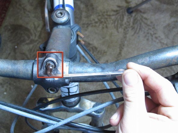 "Image 2/3: Move the bars until they're in the correct position for your stance. Tighten the faceplate nuts with a 3/8"" Allen wrench to firmly secure the handlebars in place."