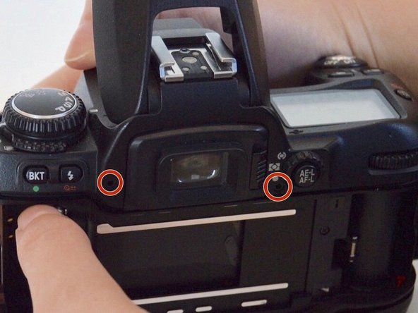 Image 1/3: Two are located by the viewfinder and and the other two are on each side of the camera.