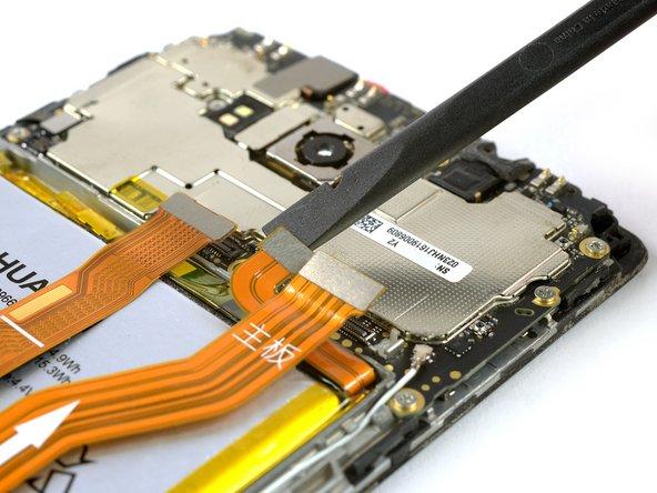 Utilisez l'extrémité plate d'une spatule pour déconnecter les  nappes d'interconnexion, de la batterie et de l'écran.