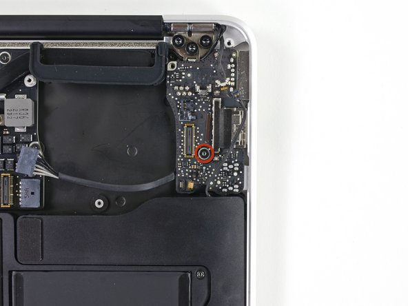 Remove the single 4.0 mm T5 Torx screw securing the I/O board to the upper case.
