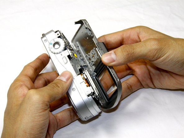 Pull the back case gently away from the rest of the camera.