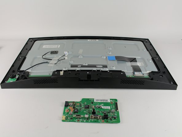 Using both hands, lift the board off of the monitor body by the motherboards base.
