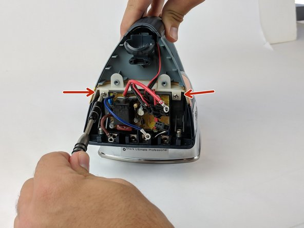 Use the Philips head #0 screwdriver to remove the two 9.82mm screws (left and right) from the white border on top of the circuit board.