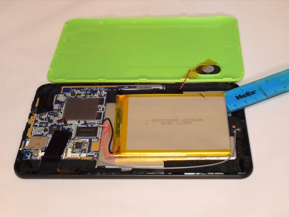 Pry the battery off the LCD using a flat and rigid piece of plastic, such as the plastic card.
