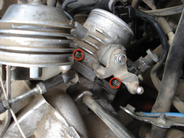 Locate the three 13mm nuts attaching the throttle body to the intake manifold.