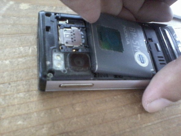 Press the eject button to open battery enclosure. Remove battery, sim card and micro sd card.