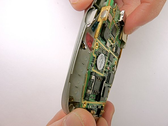 Detach the motherboard by grabbing the edges of it and lifting it straight out of the phone.