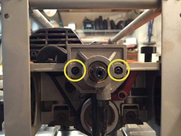 The elevating mechanism on the crank side needs to be removed to get to the drive pulley.