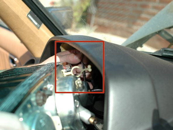 Image 1/1: Lastly, unplug the large round plug on the far left of the cluster, down and to the left of the oil gauge fitting.