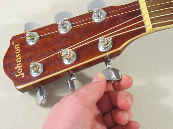 Finally, on to the guitar string instructions: Unwind the guitar key.