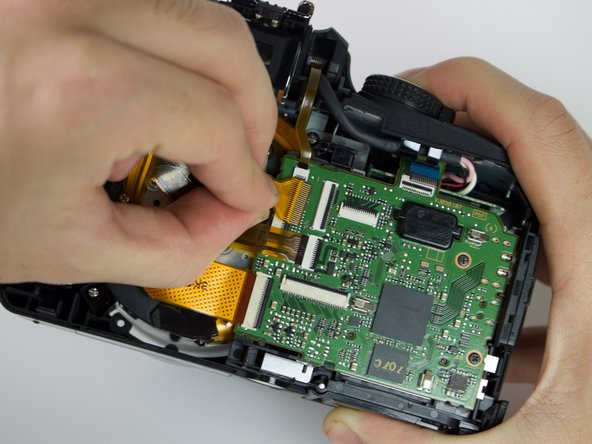 Image 2/2: Once the connector has been opened, gently pull the cable from its slot.