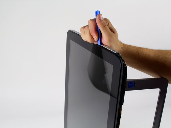 Use the plastic opening tool to separate the silver back cover from the screen body.