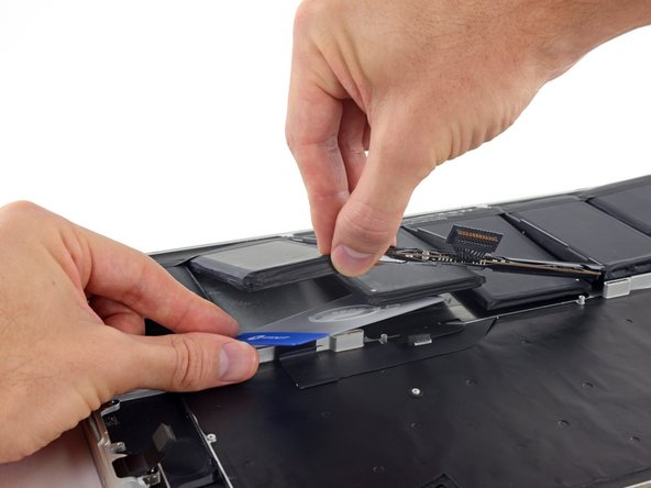 Slide your card all the way under the battery cell, and leave it to prevent the battery cell from re-adhering.