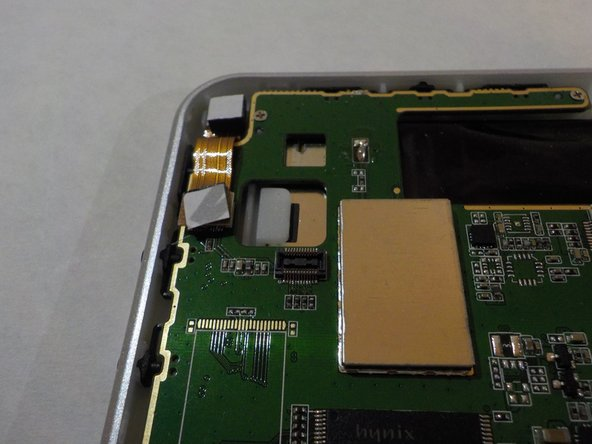Image 3/3: The bottom half of the camera strip will pop out.
