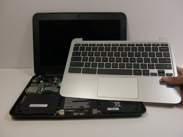Remove the keyboard assembly by lifting it off the laptop base.