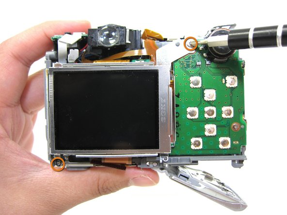 Use a #00 phillips head screwdriver to remove 2 3.34mm phillips screws holding the LCD screen in place.