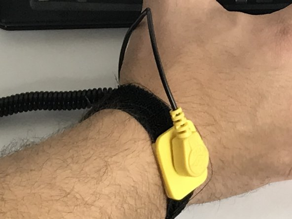 Now take your anti-static wrist strap and place it tightly  on your wrist.