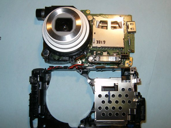 Remove the lens from the logic board.