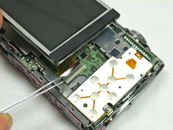 Use the tweezers to lift the ZIF connector which is holding the ribbon cables that connect the LCD screen to the motherboard.