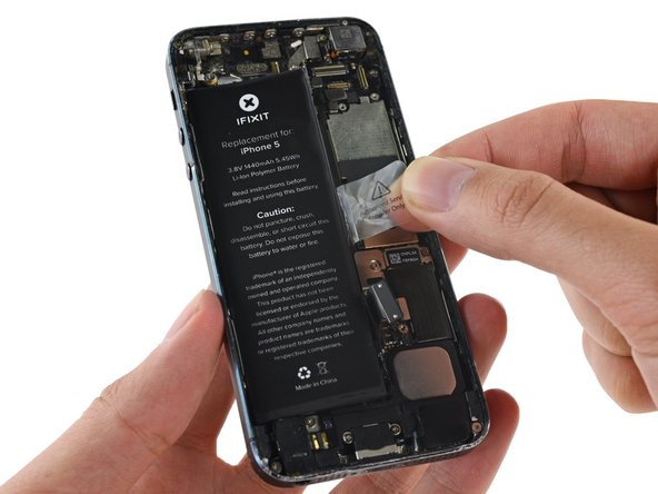 Image 1/1: If you have trouble peeling the battery up, use an iOpener or hair dryer to heat the rear case of the iPhone and soften the adhesive.