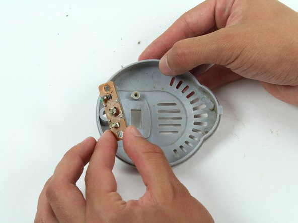 Unscrew the switch from the back panel and remove it.