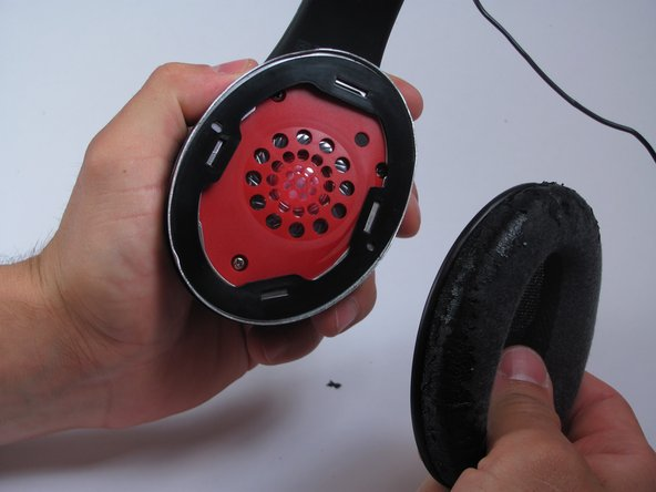 Carefully pull the cushion directly away from the earpiece.