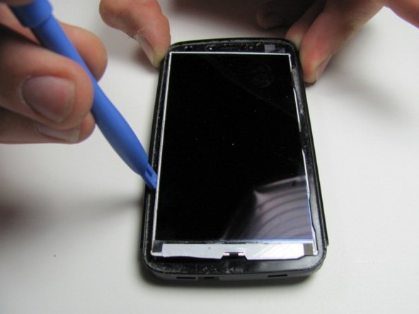 Using a plastic opening tool, slide it in between LCD screen and the case of the phone and then pry it out carefully.