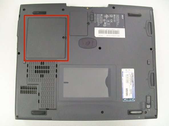 Locate the larger cover panel in the upper left hand corner of the computer.