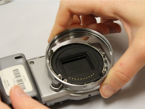 Using your fingers, easily pull off lens housing. This will complete the removal of the E-mount.