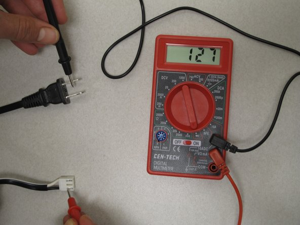 Image 1/2: The multimeter will show numbers if there is a good electrical connection.  If it does not show any numbers the first time, try using the lead to touch the other prong.